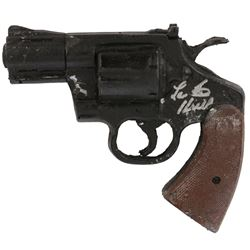 FX bent prop revolver from The Incredible Hulk signed by Lou Ferrigno.