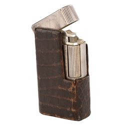 Marlene Dietrich personally owned Dunhill cigarette lighter in leather case.