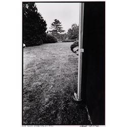 Bob Dylan oversize peek-a-boo portrait photographby Elliot Landy