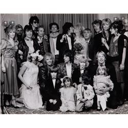 Ronnie and Jo Wood wedding party portrait featuring Rod Stewart, Keith Richards, Peter Frampton.