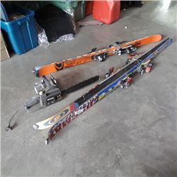 2 pair of Soloman skis and electric chainsaw
