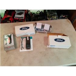 2 NEW FORD CLOCKS, SWISS FORCE DETOUR VEHICLE ESCAPE TOOL AND READING GLASSES