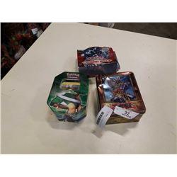 2 TINS OF YU GI OH AND BOX OF POKEMON CARDS