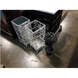 Two decorative metal umbrella stands and metal plant