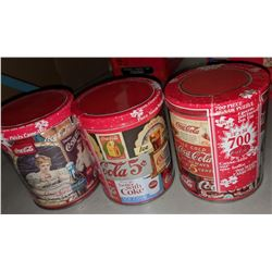 Three jigsaw Coca Cola puzzle sets in collector tins