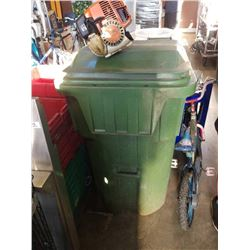 Large green garbage can with built-in lid