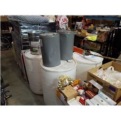 3 plastic barrels and three metal jugs