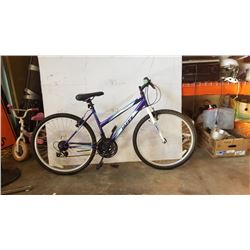 BLUE AND WHITE HUFFY BIKE