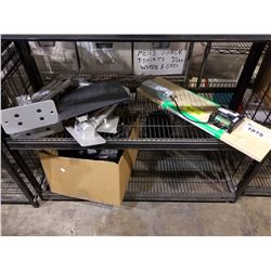 SHELF LOT OF ASSORTED SET DEC PRINTS MONITOR MOUNTS, PROP PANEL AND BOX OF SHIN PADS