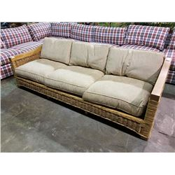 WICKER COUCH WITH BEIGE CUSHIONS