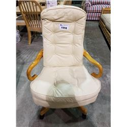 BEIGE LEATHER AND WOOD ROLLING OFFICE CHAIR