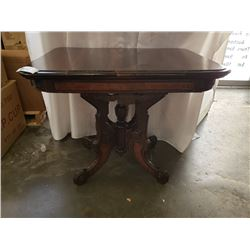 ANTIQUE AMERICAN WALNUT AND ROSEWOOD PARLOR TABLE
