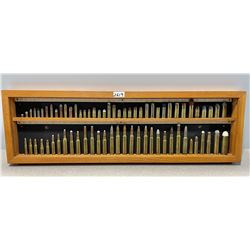 AMMO: COLLECTION OF 70+ CARTRIDGES IN WOOD DISPLAY
