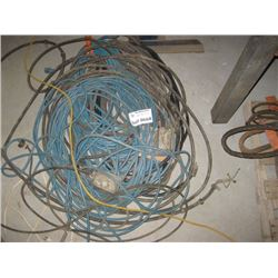 PILE OF EXTENSION CORDS