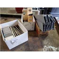 Three boxes of large bolts cabinet hardware and aluminum