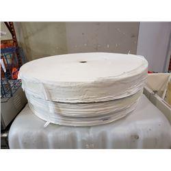 Three huge paper rolls approximately 3 feet in diameter