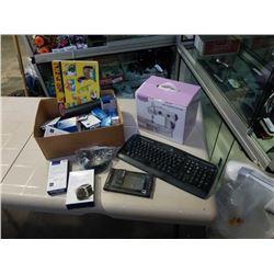 New mini sewing machine with box of new electronics