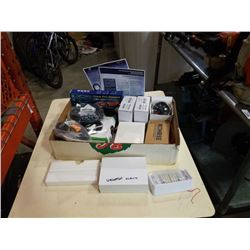 Box of new tire gauges, inner tubes and more