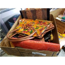 Box of ladies leather bags and wallets