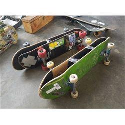 4 skateboards