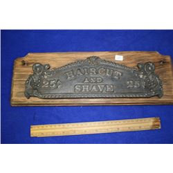 "Cast Iron Sign ""Hair Cut and Shave 25¢"""
