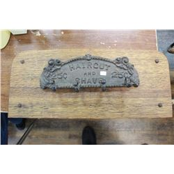 """Cast Iron Sign """"Hair Cut and Shave 25¢"""" - Mounted on an Oak Board"""