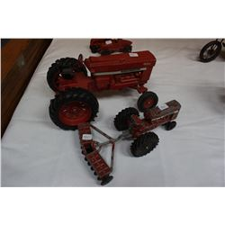Two Toy International Tractors & 1 Disc