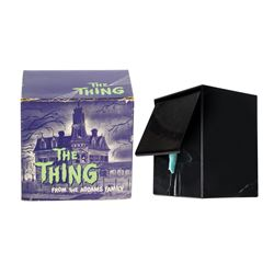 The Thing from The Addams Family Coin Bank.