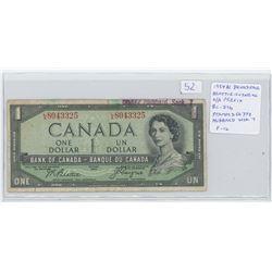 1954 $1 Devil's Face $1 note. Beattie-Coyne signatures. L/A. Prefix. BC-29b. Ink Stamped 66372 Hubba