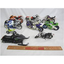 Lot of 8 vintage plastic motorcycles and one die cast snowmobile