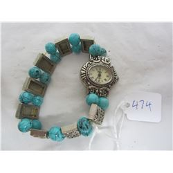 Vintage turquoise and silver colored watch needs battery