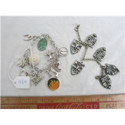 Lot of 2 charm bracelets the one on left is sterling most charms are marked one on right is not ster