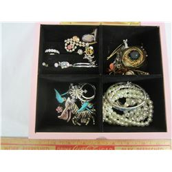 Vintage jewelry box full of costume jewelry