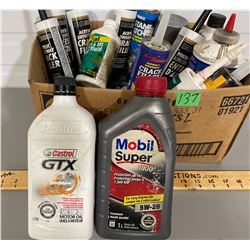 BOX LOT OF CAULKING AND OIL