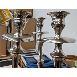 3 candelabras with candles