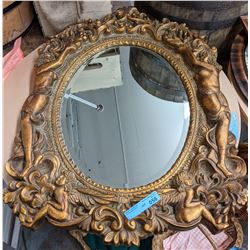 Ornate gold mirror from the show