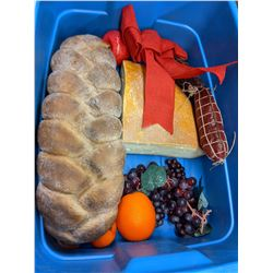 Assorted fake food and box of miscellaneous