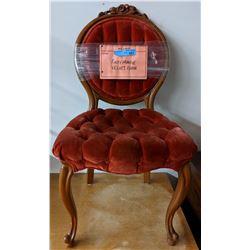 Rusty orange velvet chair (approx. 3 ft tall)