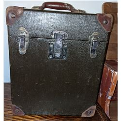 Carnival scee bucket, period reproduction trash can, brown leather desk blotter and vintage suitcase