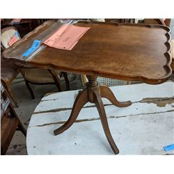 Barbers shop table from scene. Wooden table approx 2 feet high the 1930's end table