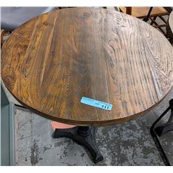 Round wooden bistro table