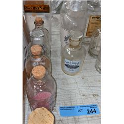 Approx 10 apothecary bottles