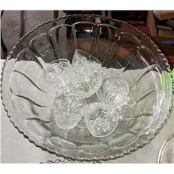 2 punch bowls with glasses and ladles