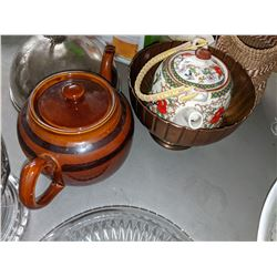 Teapots glasses candle and misc kitchen items.