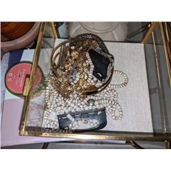 Assorted costume jewelry makeup kits and tray