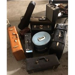 7 vintage suitcases and 2 small vintage bags and 1 vintage violin cover