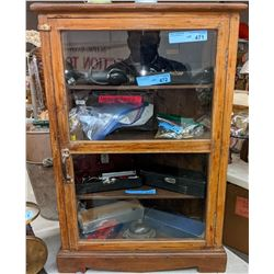 Antique wooden store display with glass and photos book about the 1920s