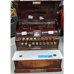Antique national cash register with key