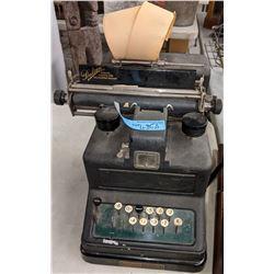 Antique Dalton adding machine and Movie prop gun