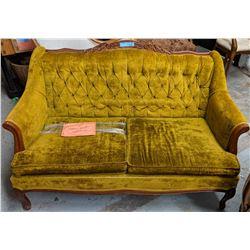 Antique green velvet love seat